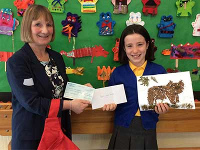 Y4 pupil Frances from Corbridge CE First School and Brenda Fleming, Supply Chain Supervisor at JDP