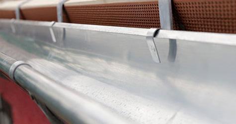A piece of galvanised steel guttering pipe.