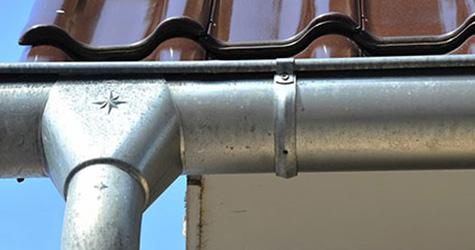 A piece of zinc guttering pipe.