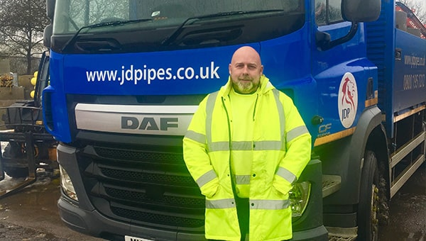 Stephen Cooper in front of JDP lorry.
