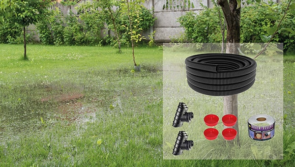 Flooded garden with land drainage garden pack on top.