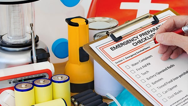 An emergency preparation checklist alongside batteries and torches.