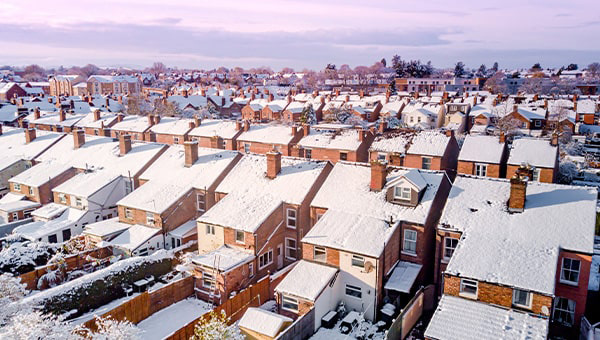 Rows of snow covered houses.