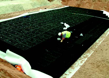 Membrane around an attenuation tank being installed.