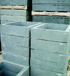 Rectangular concrete chamber sections.