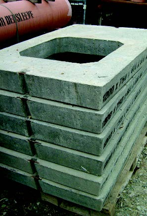 Rectangular concrete cover slabs.